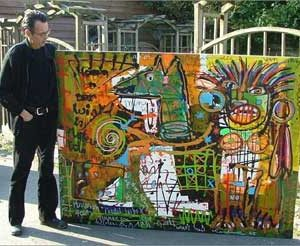 Jacob Kanbier with a painting in his distinctive style in 2005