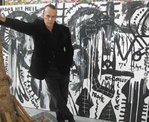 "Jacob Kanbier with the black and white painting ""Everlasting love"" in his gallery in Leiden in 2010"