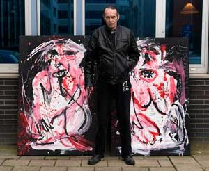 "Jacob Kanbier with the painting ""Mind your own Monkey Business"" outside his gallery in Leiden in 2011"