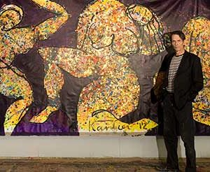 "Jacob Kanbier with the painting ""Golden Ladies"" in his gallery in Leiden in 2012"
