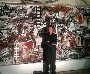 "Jacob Kanbier with his painting ""Temple of Fine Art"" in his gallery in Leiden in 2012"