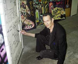 Jacob Kanbier drawing on a door during an exposition in 2014