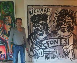 "Jacob Kanbier with his painting ""Stones"" at his home in 2016"