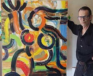 Jacob Kanbier with his oil painting at home in 2017